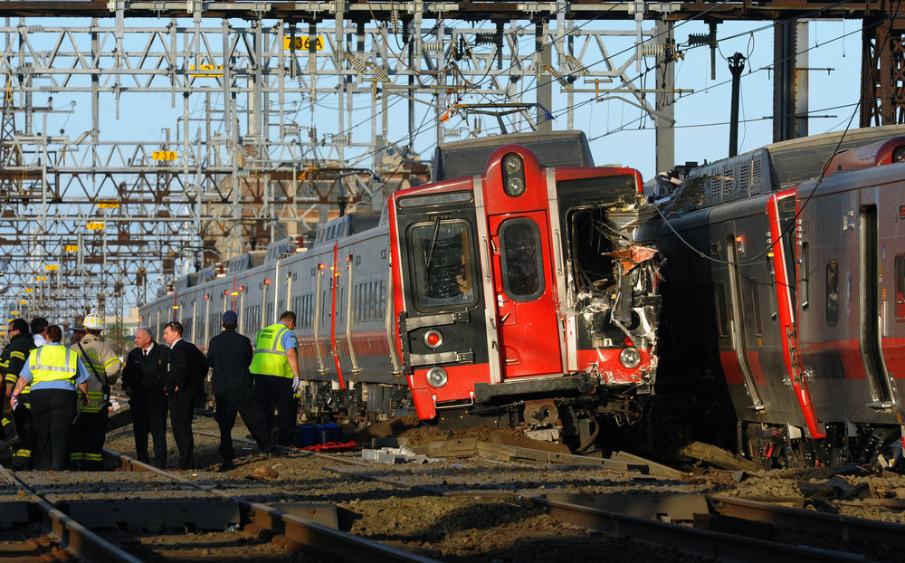 . Emergency workers arrive at the scene of a train collision, Friday, May 17, 2013 in Fairfield, Conn. Two Metro North commuter trains serving New York City collided during Friday\'s evening rush hour, sending 60 people to the hospital, including five with critical injuries, Gov. Dannel Malloy said.  (AP Photo/The Connecticut Post, Christian Abraham)