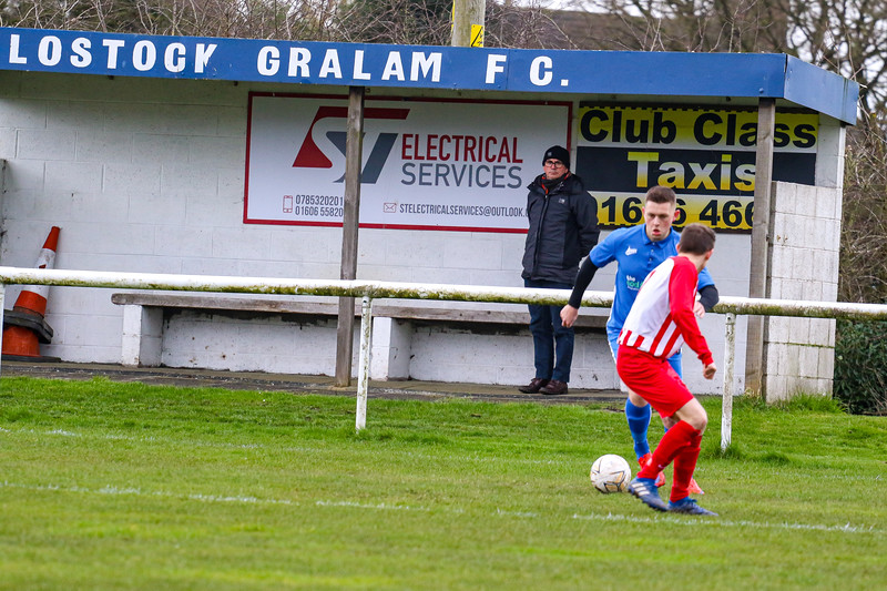 A single Lostock Gralam fan stands alone in the clubs sheltered stand, this was Lostocks first fixture of the 2020/21 season vs St Helen's