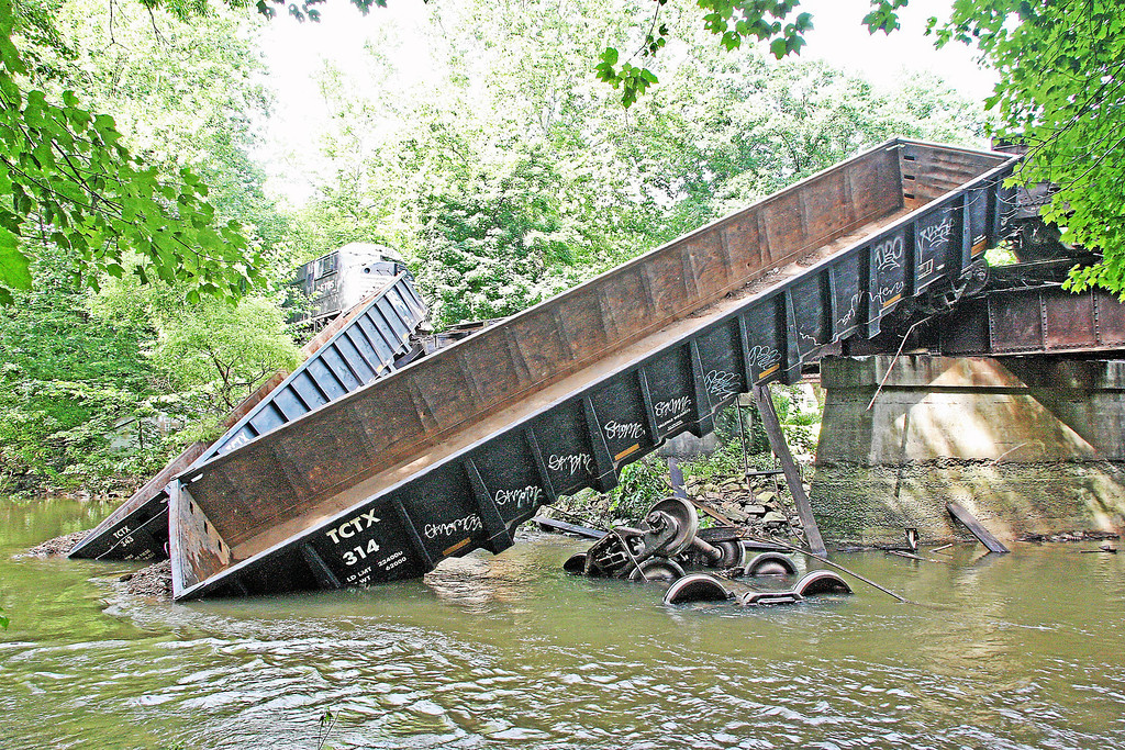 . Two cars lie partway off a bridge in the Brandywine Creek following a train derailment in Valley on Monday, July 8, 2013.