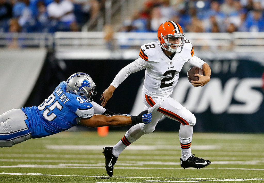 . Cleveland Browns quarterback Johnny Manziel (2) breaks the tackle of Detroit Lions outside linebacker Kyle Van Noy (95) in the first half of a preseason NFL football game at Ford Field in Detroit, Saturday, Aug. 9, 2014.  (AP Photo/Rick Osentoski)