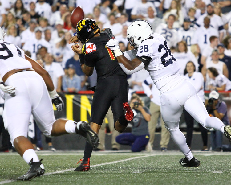 Penn State DE #28 Jayson Oweh forces a fumble from Maryland QB #17 Josh Jackson