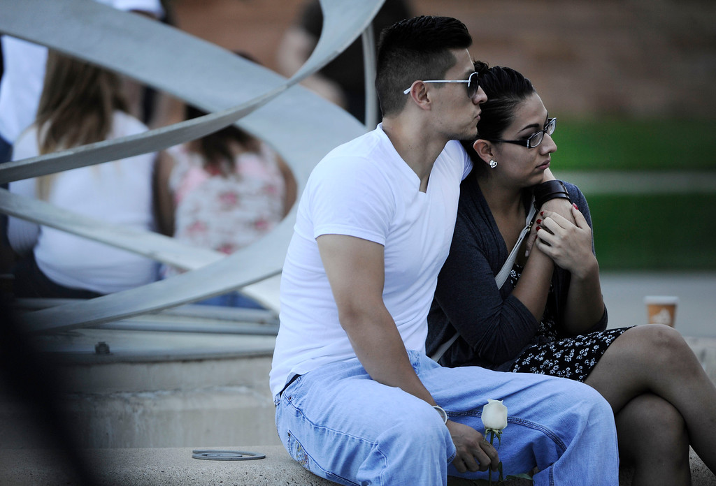 . AURORA, CO - JULY 20:  Greg and Michelle Orio pause and reflect at the 7/20 Day of Remembrance 2013 at the Aurora Municipal Center Saturday morning, July 20, 2013. Over 200 people attended the service in honor of the 12 people killed and over 60 people injured in last years Aurora theater shooting. The service included prayer, songs and speeches from local officials and the Governor of Colorado, John Hickenlooper. (Photo By Andy Cross/The Denver Post)