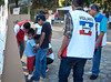 Election day in Santa Ana: <br /> Vigilantes help voters locate the proper voting table.