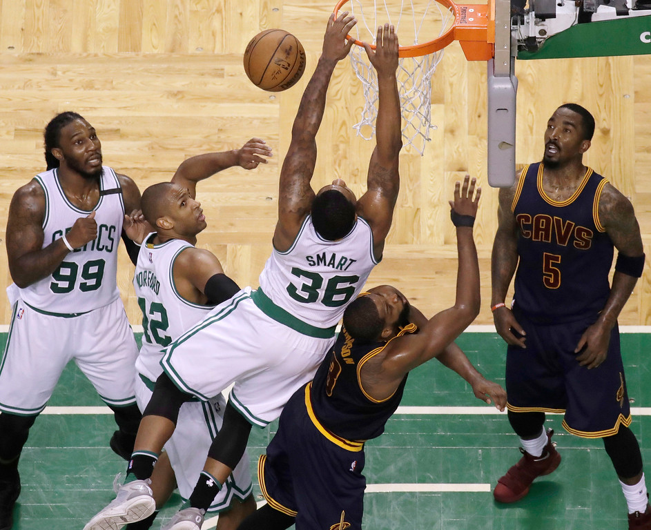 . Boston Celtics guard Marcus Smart (36) tries to dunk over Cleveland Cavaliers center Tristan Thompson (13) during the second half of Game 2 of the NBA basketball Eastern Conference finals, Friday, May 19, 2017, in Boston. (AP Photo/Elise Amendola)