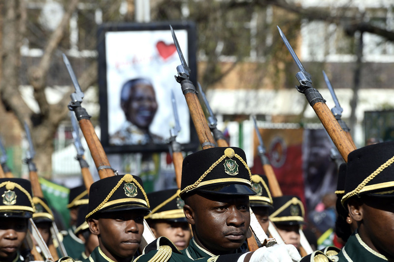 """. Members of the South African Army parade to wish a happy birthday to former South African President Nelson Mandela on July 18, 2013 outside the Medi Clinic Heart Hospital in Pretoria. Mandela\'s health is \""""steadily improving\"""", South Africa\'s presidency said on July 18 as the anti-apartheid legend began spending his 95th birthday in hospital. Children in schools around the country kicked off the celebrations by singing \""""Happy Birthday\"""" to Mandela, on a day that also marked the 15th anniversary of his marriage to third wife Graca Machel.The United Nations declared the Nobel Peace laureate\'s birthday Mandela Day in 2010, but for many this year it takes on extra poignancy.  STEPHANE DE SAKUTIN/AFP/Getty Images"""