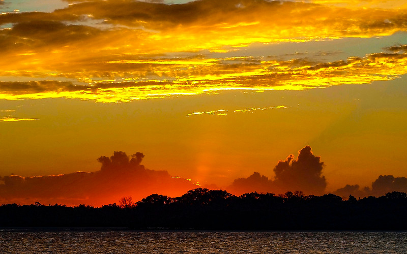 Yellow colored stratus cloud, sunset seascape.