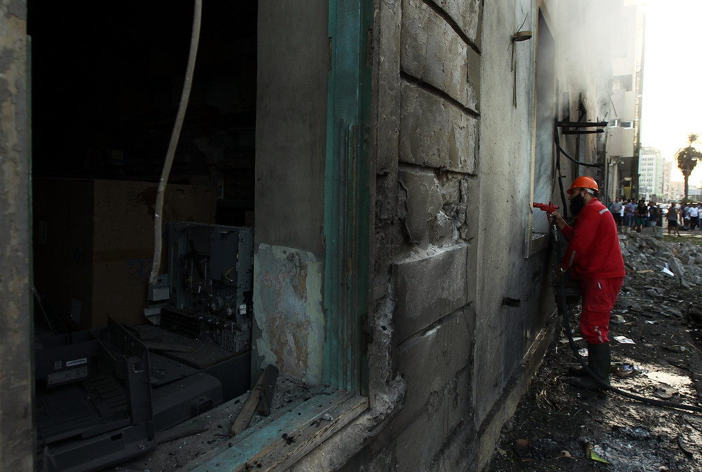 . A Libyan firefighter waters the inside of a foreign ministry building that was damaged by a powerful blast on September 11, 2013 in the eastern Libyan city of Benghazi. The explosion comes on the first anniversary of an attack by militants on the United States consulate in Benghazi, which killed four Americans, including the ambassador. ABDULLAH DOMA/AFP/Getty Images