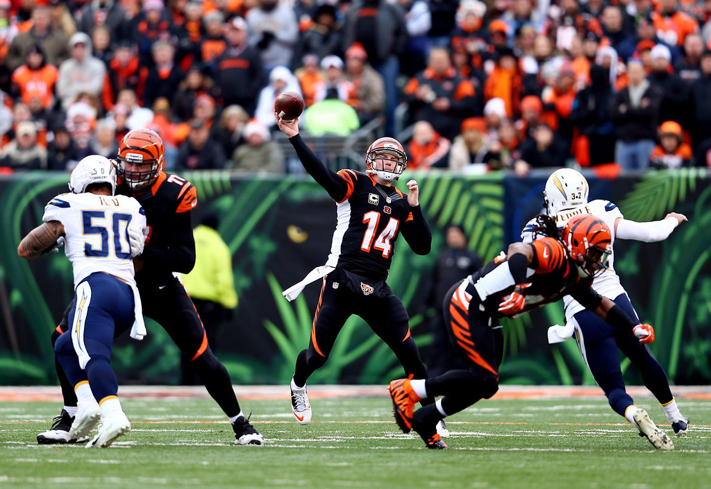 . Quarterback Andy Dalton #14 of the Cincinnati Bengals passes against the San Diego Chargers during a Wild Card Playoff game at Paul Brown Stadium on January 5, 2014 in Cincinnati, Ohio.  (Photo by Andy Lyons/Getty Images)