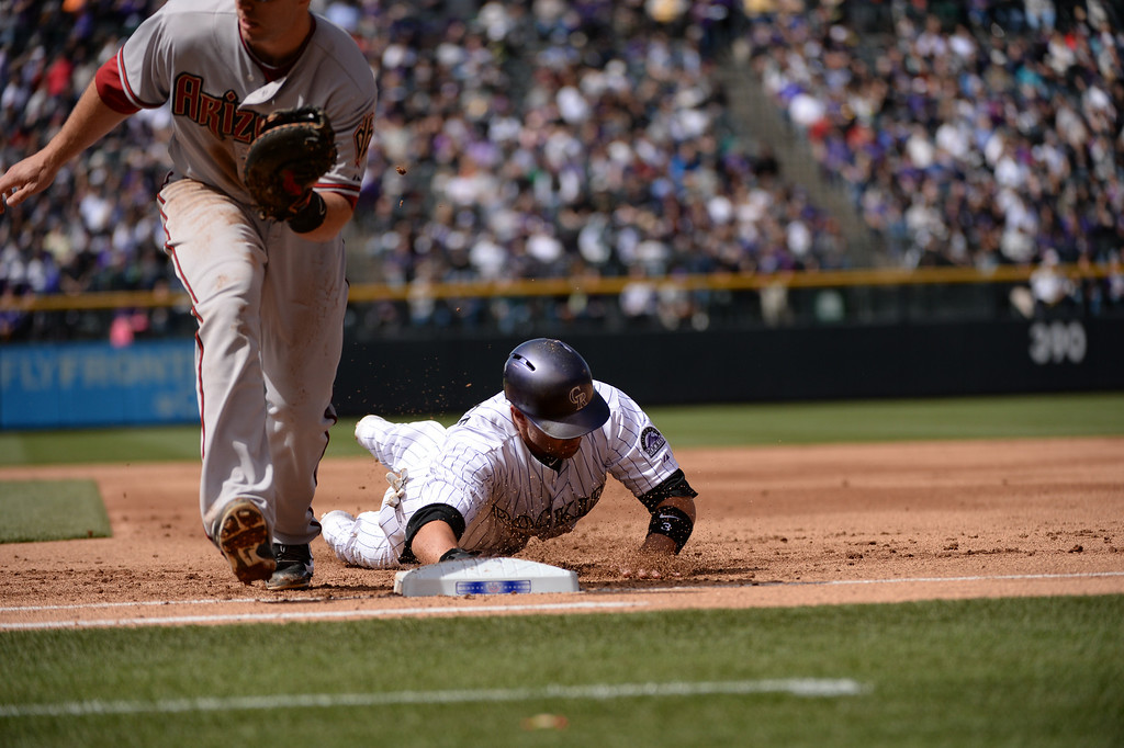 . Michael Cuddyer avoids being picked off at first base during the first inning. The Colorado Rockies hosted the Arizona Diamondbacks in the Rockies season home opener at Coors Field in Denver, Colorado Friday, April 4, 2014. (Photo by Hyoung Chang/The Denver Post)