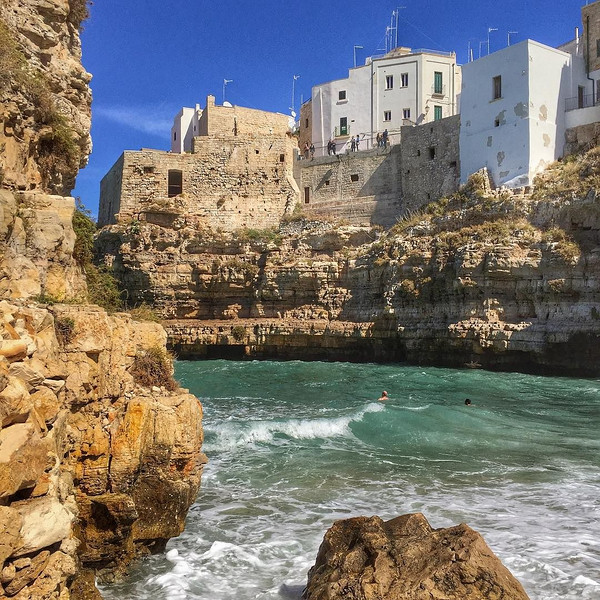 A little dip -- Polignano a Mare, Italy. The nifty thing about Puglia, the heel of Italy's boot: when you need a break from the towns and cities, the sea is close at hand. via Instagram http://ift.tt/1XC4IUN