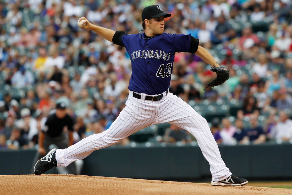 . Colorado Rockies starting pitcher Collin McHugh works against the Milwaukee Brewers in the first inning of a baseball game in Denver on Saturday, July 27, 2013. (AP Photo/David Zalubowski)