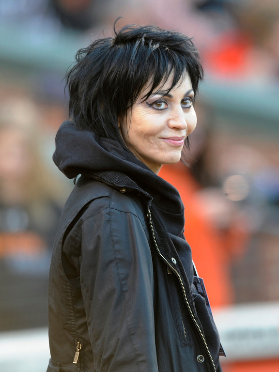 . Singer and songwriter Joan Jett  smiles during an on field ceremony in memory of Earl Weaver before the Baltimore Orioles and Los Angeles Dodgers second baseball game of a doubleheader Saturday, April 20, 2013 in Baltimore. (AP Photo/Gail Burton)
