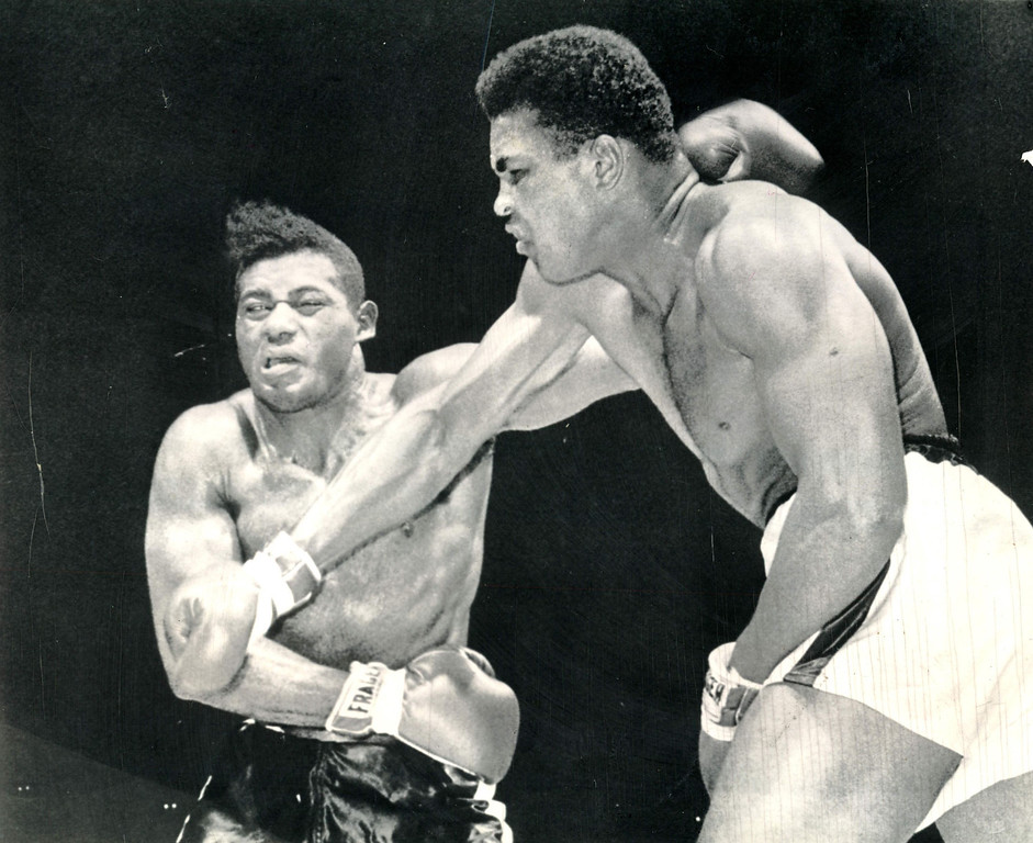 . CLAY LANDS A SMASH--Champion Cassius Clay lands a right smash to the jaw of challenger Floyd Patterson in the seventh round of their title fight at Las Vegas, Nev.  (AP Wirephoto) 1965 Heavyweight champion Cassius Clay lands a hard right tot he face of challenger Floyd Patterson in the seventh round of title fight in Las Vegas on Nov. 22.  Clay gave Patterson a severe beating before fight was stopped in the 12th. Clay was still at it in the seventh round, pouring a barrage of blows to Patterson\'s head.  This one makes the challenger\'s eyes roll and it\'s obvious he\'s in more than a little pain. Credit: AP