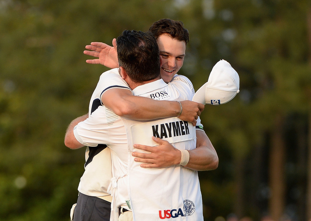 . (L-R) Martin Kaymer of Germany and caddie Craig Connelly celebrate Kaymer\'s eight-stroke victory on the 18th green during the final round of the 114th U.S. Open at Pinehurst Resort & Country Club, Course No. 2 on June 15, 2014 in Pinehurst, North Carolina.  (Photo by Ross Kinnaird/Getty Images)