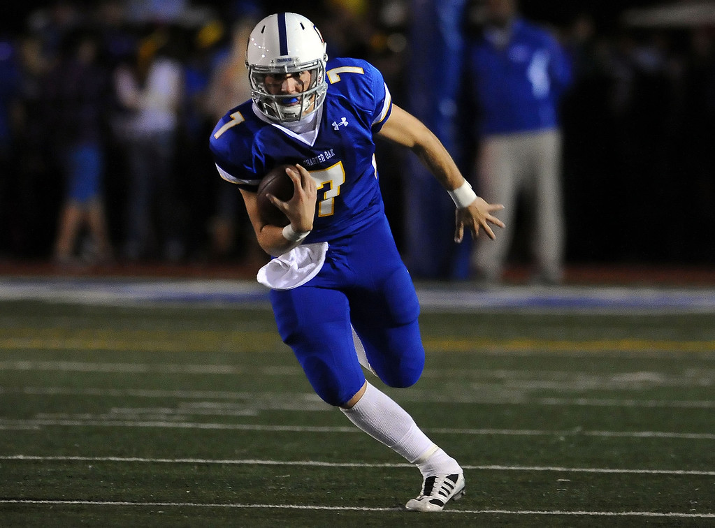 . Charter Oak quarterback Kory Brown (7) scrambles in the first half of a prep football game against Damien at Charter Oak High School in Covina, Calif., Friday, Oct. 11, 2013.    (Keith Birmingham Pasadena Star-News)