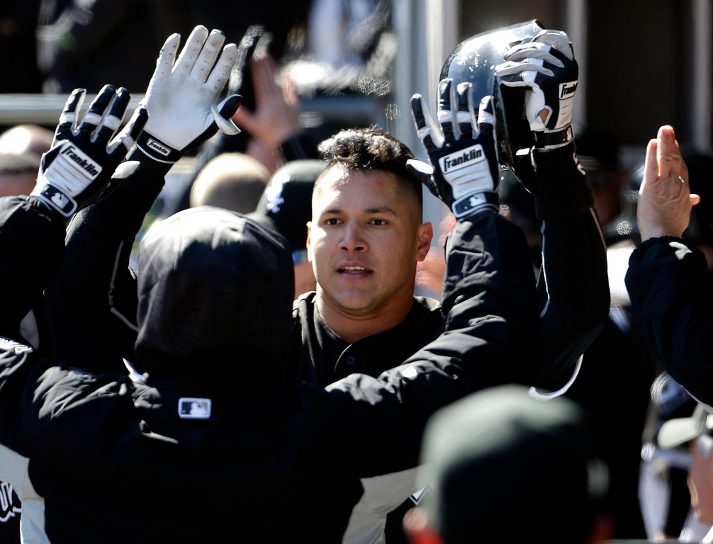. Chicago White Sox\'s Avisail Garcia celebrates with teammates after hitting a three-run home run during the seventh inning of a baseball game against the Cleveland Indians on Saturday, April 9, 2016, in Chicago. (AP Photo/Nam Y. Huh)