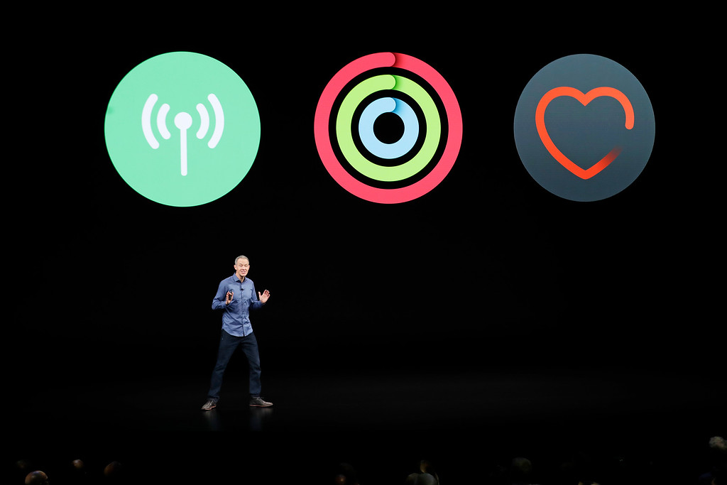 . Jeff Williams, Apple\'s chief operating officer, speaks about the Apple Watch Series 4 at the Steve Jobs Theater during an event to announce new Apple products Wednesday, Sept. 12, 2018, in Cupertino, Calif. (AP Photo/Marcio Jose Sanchez)