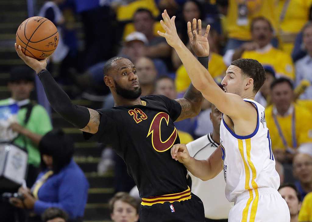 . Cleveland Cavaliers forward LeBron James (23) passes as he is guarded by Golden State Warriors guard Klay Thompson during the first half of Game 5 of basketball\'s NBA Finals in Oakland, Calif., Monday, June 12, 2017. (AP Photo/Marcio Jose Sanchez)