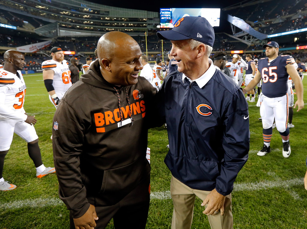 . Cleveland Browns head coach Hue Jackson and Chicago Bears head coach John Fox greet each other after an NFL preseason football game, Thursday, Aug. 31, 2017, in Chicago. The Browns won 25-0. (AP Photo/Charles Rex Arbogast)