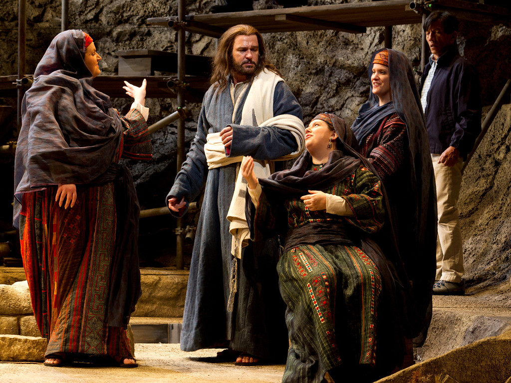 ". Yeshua (Nathan Gunn), center, is heckled by three women as he preaches at the Temple of Capernaum, in a scene from San Francisco Opera\'s world premiere of Mark Adamo\'s ""The Gospel of Mary Magdalene,\"" Sunday, June 16, 2013 at the War Memorial Opera House in San Francisco. (D. Ross Cameron/Bay Area News Group)"