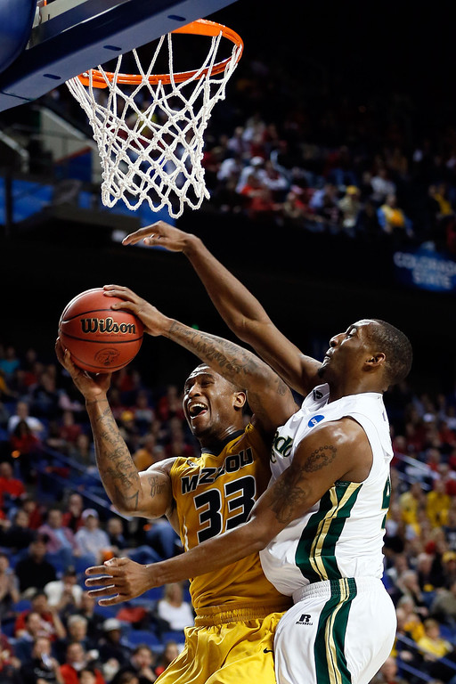 . LEXINGTON, KY - MARCH 21:  Earnest Ross #33 of the Missouri Tigers goes to the hoop drawing the foul against Greg Smith #44 of the Colorado State Rams during the second round of the 2013 NCAA Men\'s Basketball Tournament at the Rupp Arena on March 21, 2013 in Lexington, Kentucky.  (Photo by Kevin C. Cox/Getty Images)