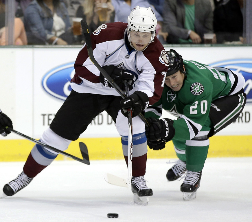. Colorado Avalanche center John Mitchell (7) and Dallas Stars center Cody Eakin (20) compete for control of a loose puck in the first period of a preseason NHL hockey game on Thursday, Sept. 26, 2013, in Dallas. (AP Photo/Tony Gutierrez)