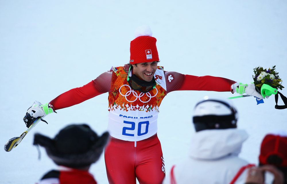 . Gold medalist Sandro Viletta of Switzerland celebrates during the flower ceremony for the Alpine Skiing Men\'s Super Combined Downhill on day 7 of the Sochi 2014 Winter Olympics at Rosa Khutor Alpine Center on February 14, 2014 in Sochi, Russia.  (Photo by Doug Pensinger/Getty Images)