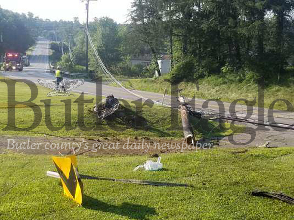 A portion of Route 228 east in Middlesex Township is closed after a car crash about 8 a.m. Monday sheared off a utility pole and knocked down power lines. The road is closed between Sandy Hill and Logan roads while West Penn Power crew responds.Jim Smith/Butler Eagle. This pic is small no more than 2 col!!!!!!!