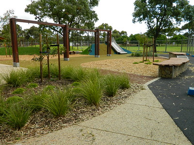 quad timber swing and climbing rope and timber and gabion seating with slide on mound