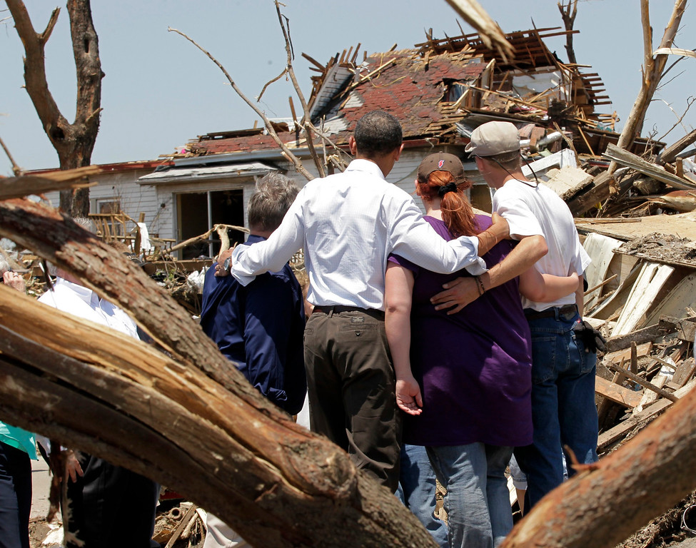. President Barack Obama, second from left, with residents views damage from the tornado that devastated Joplin, Mo., Sunday, May 29, 2011.   (AP Photo/J. Scott Applewhite)