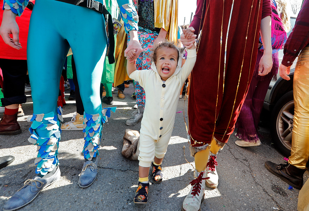 . Sher Morgenstern, 2, walks in costume with her family during the Society de Sainte Anne parade, on Mardi Gras day in New Orleans, Tuesday, Feb. 13, 2018. (AP Photo/Gerald Herbert)
