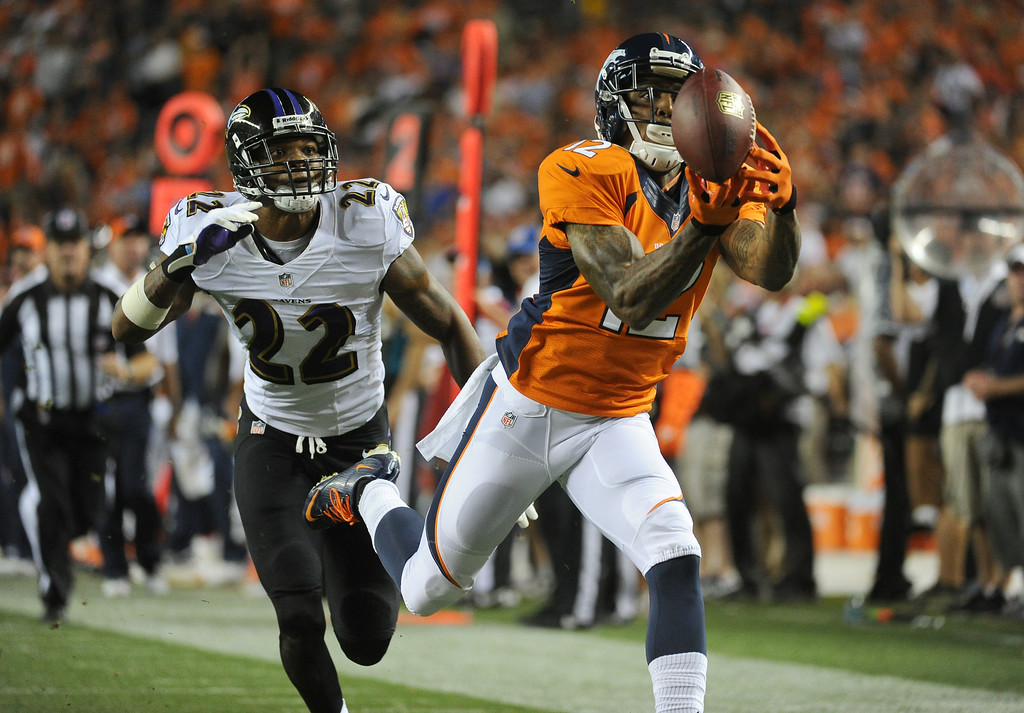 . DENVER, CO - SEPTEMBER 05: Denver Broncos wide receiver Andre Caldwell (12) catches a pass for a touchdown in the third quarter. The Denver Broncos took on the Baltimore Ravens in the first game of the 2013 season at Sports Authority Field at Mile High in Denver on September 5, 2013. (Photo by Tim Rasmussen/The Denver Post)