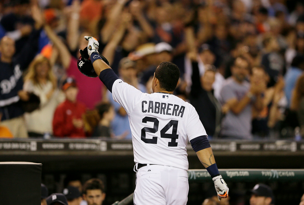 . Detroit Tigers\' Miguel Cabrera acknowledges the crowd after his solo home run during the third inning of an interleague baseball game against the Colorado Rockies, Saturday, Aug. 2, 2014, in Detroit. (AP Photo/Carlos Osorio)