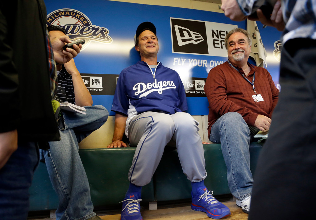 . Los Angeles Dodgers manager Don Mattingly talks to reporters before a baseball game against the Los Angeles Dodgers Wednesday, May 22, 2013, in Milwaukee. (AP Photo/Morry Gash)