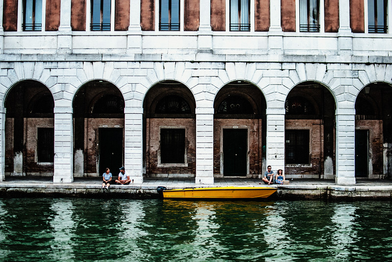 venice boat yellow people sitting on edge water summer.jpg