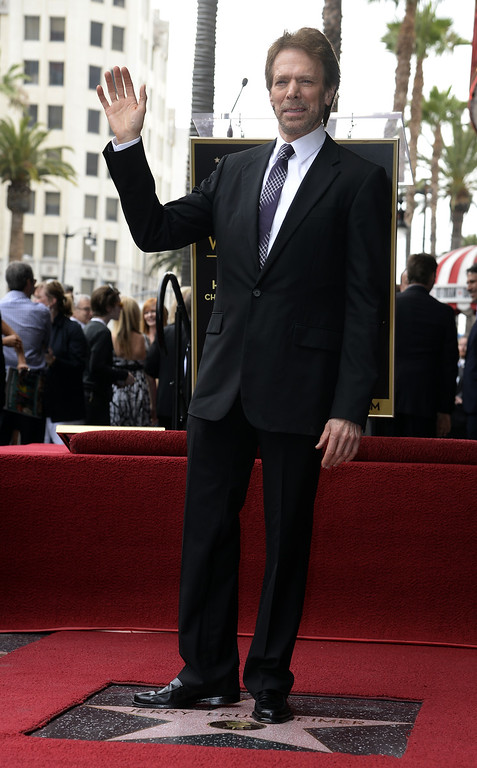 . US producer Jerry Bruckheimer stands on his star during a ceremony honoring him on the Hollywood Walk of Fame in Hollywood, California, USA, 24 June 2013. Bruckheimer received the 2,501st star on the Hollywood Walk of Fame.  EPA/MICHAEL NELSON