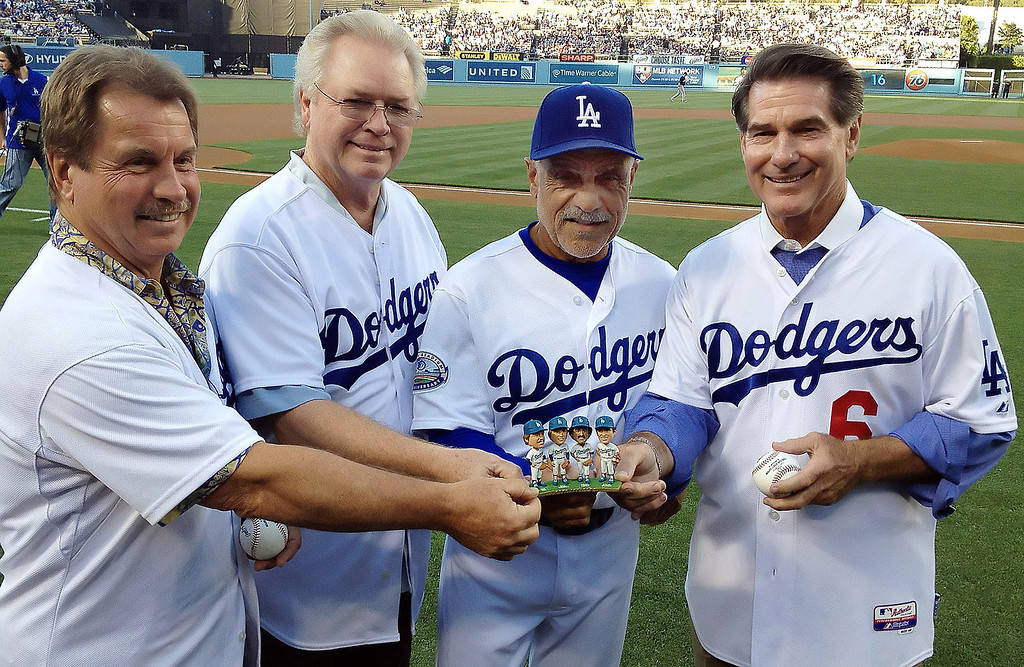 ". Bobblehead night featuring the ""Infield\"" from left to right Ron Cey, Bill Russell, Davey Lopes and Steve Garvey prior to a baseball game between the Milwaukee Brewers and the Los Angeles Dodgers on Tuesday, May 29, 2012 in Los Angeles. The Infield played together from 1971 to 1983.    (Keith Birmingham/Pasadena Star-News)"
