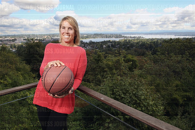Former Olympian and WNBA Seattle Storm co-owner Ginny Gilder is pictured on the deck of her Seattle, Washington home