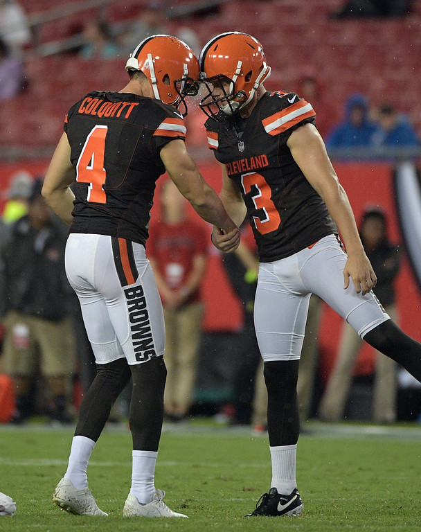 . Cleveland Browns kicker Cody Parkey (3) celebrates with Britton Colquitt (4) after a field goal against the Tampa Bay Buccaneers during the fourth quarter of an NFL preseason football game Saturday, Aug. 26, 2017, in Tampa, Fla. (AP Photo/Phelan Ebenhack)
