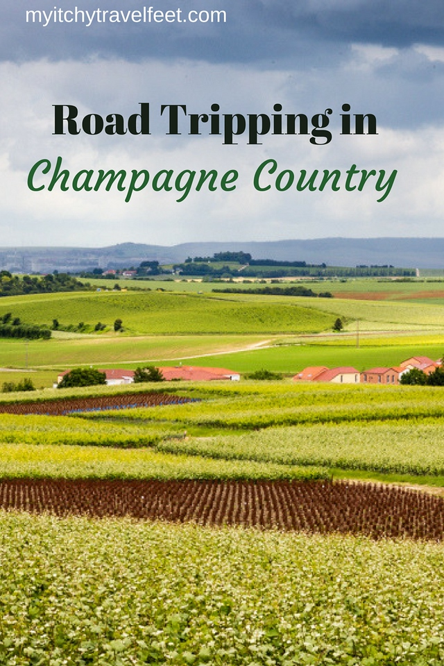 Text: road tripping in champagne country. Photo: green fields with a stormy sky