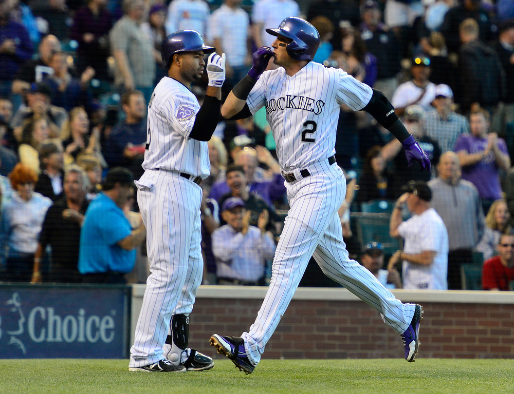 . DENVER, CO - MAY 21: Troy Tulowitzki (2) of the Colorado Rockies celebrates his home run off of Ian Kennedy (31) of the Arizona Diamondbacks during action at Coors Field. The Arizona Diamondbacks visited the Colorado Rockies. (Photo by AAron Ontiveroz/The Denver Post)