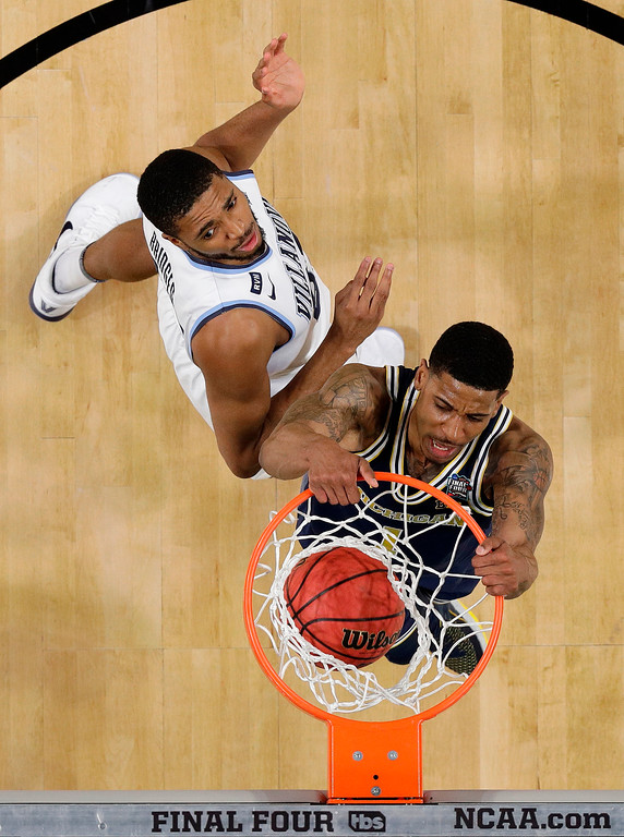 . Michigan\'s Charles Matthews (1) dunks past Villanova\'s Mikal Bridges during the second half in the championship game of the Final Four NCAA college basketball tournament, Monday, April 2, 2018, in San Antonio. (AP Photo/Eric Gay)