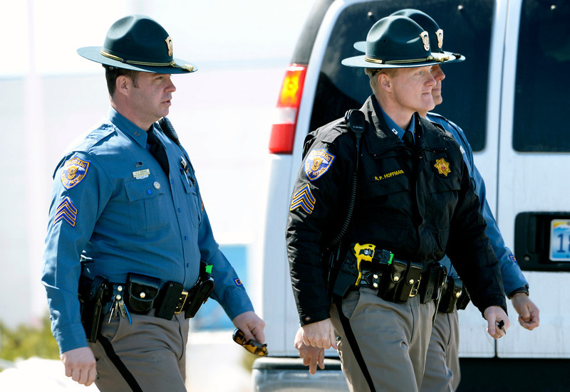 . Sgt. Rick Hoffmann and other members of the Colorado State Patrol leave the New Life Church after the public memorial service for Tom Clements on March 25, 2013.  Hundreds of friends and family, correction and police officers turned out to pay their respects to Clements.  Clements, who was the executive director of the Colorado Department of Corrections, was shot and killed as he opened the door to his Monument home on March 19, 2013.  (Photo By Helen H. Richardson/ The Denver Post)
