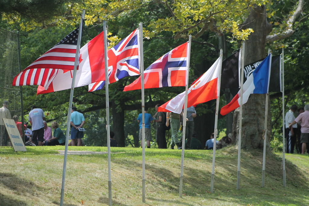 . Flags of the nations that were involved in World War II are displayed  at D-Day Conneaut 2018. Nations include the United States, Canada,  Britain, France, Germany and Poland. Kristi Garabrandt - The News-Herald