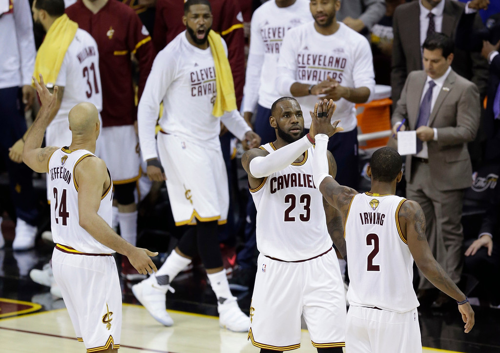 . Cleveland Cavaliers forward LeBron James (23) and teammate Kyrie Irving (2) celebrate during the first half against the Golden State Warriors in Game 4 of basketball\'s NBA Finals in Cleveland, Friday, June 9, 2017. (AP Photo/Tony Dejak)
