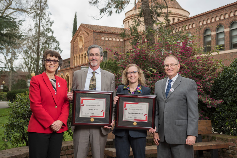 President Gayle Hutchinson, Behavioral and Social Sciences 2018 Distinguished Alumni Tim Beach (GEOG, '82) Sheryl Beach (GEOG, '82), Eddie Vela (Dean, BSS) (left to right) take a photo after the presentation of plaques on Friday, March 9, 2018 in Chico, Calif.  (Jason Halley/University Photographer/CSU Chico)