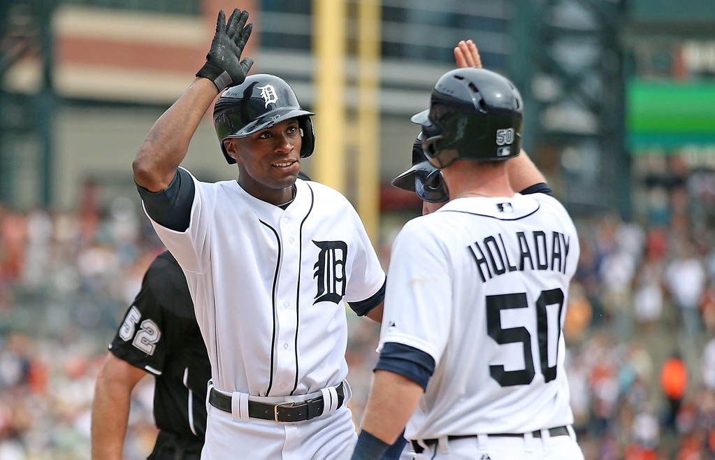. Detroit\'s Austin Jackson, left, celebrates with teammate Bryan Holaday after his three-run homer in the sixth inning against the Twins.  (Photo by Leon Halip/Getty Images)