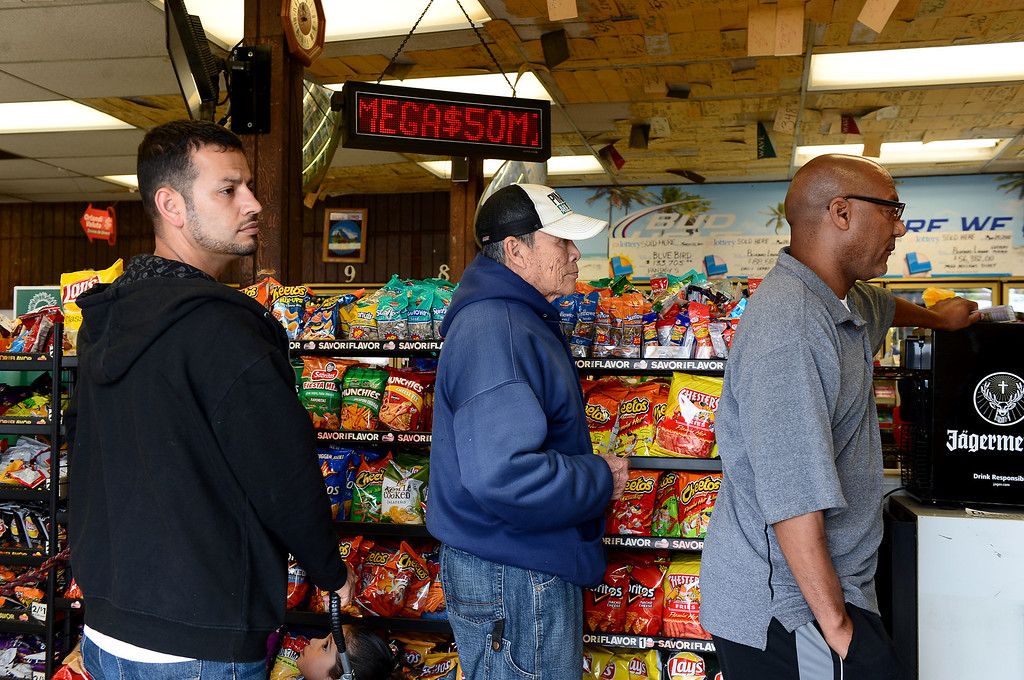 . People lineup to purchase lottery tickets Thursday, April 4, 2013 at Bluebird Liquor in Hawthorne. The liquor store is one of the top 3 places to buy Super Lotto Plus and Mega Millions lottery tickets. Powerball Lottery is coming to California for the first time Monday. (SGVN/Staff Photo by Sarah Reingewirtz)