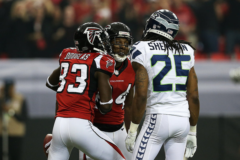 . Roddy White #84 and  Harry Douglas #83 of the Atlanta Falcons celebrate White\'s second quarter touchdown against the Seattle Seahawks during the NFC Divisional Playoff Game at Georgia Dome on January 13, 2013 in Atlanta, Georgia.  (Photo by Streeter Lecka/Getty Images)