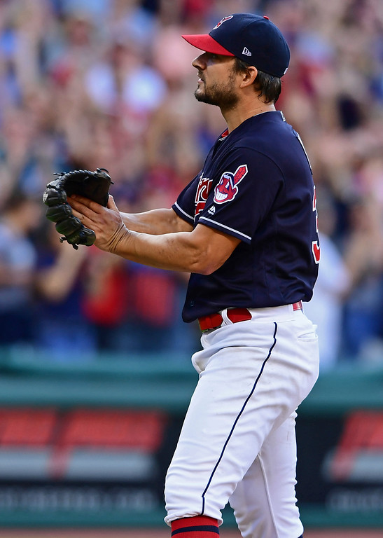 . Cleveland Indians relief pitcher Brad Hand celebrates after defeating the Detroit Tigers 15-0 in a baseball game, Saturday, Sept.15, 2018, in Cleveland. (AP Photo/David Dermer)
